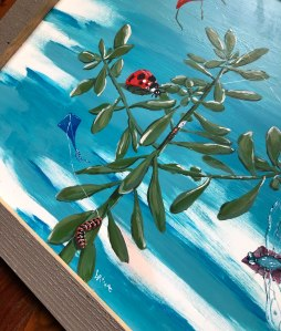 Brina Schenk's painting Insect Kite Festival - acrylic on metal, painted in Fernie, BC Canada