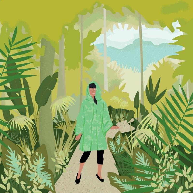 Woman wearing raincoat in the rainforest - meandering in the rainforest is good for the soul